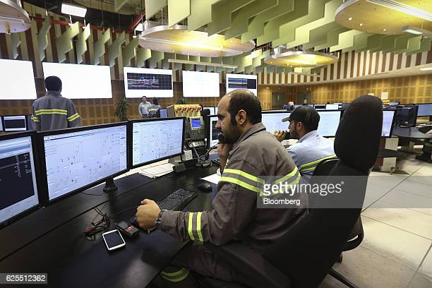 Ma'aden workers sit and monitor computer screens inside the control room of the aluminium processing plant at the Ras Al Khair Industrial City...