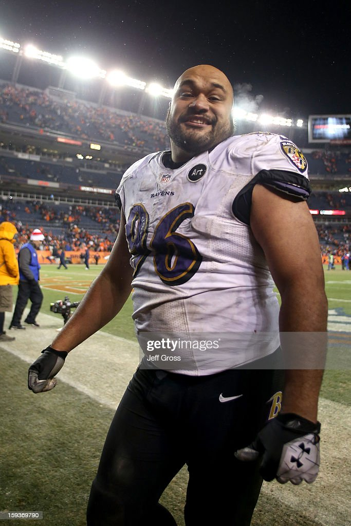 Ma'ake Kemoeatu of the Baltimore Ravens celebrates as he walsk off the field after the Ravens won 3835 in the second overtime against the Denver...