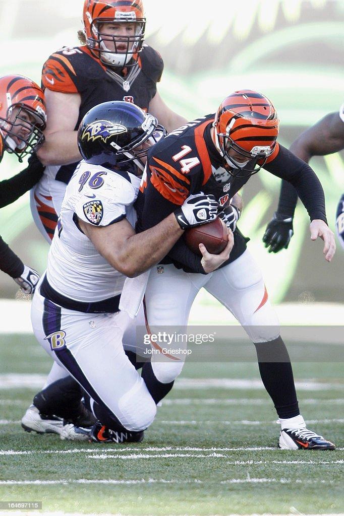 Ma'ake Kemoeatu of the Baltimore Ravens sacks Andy Dalton of the Cincinnati Bengals during their game at Paul Brown Stadium on December 30 2012 in...