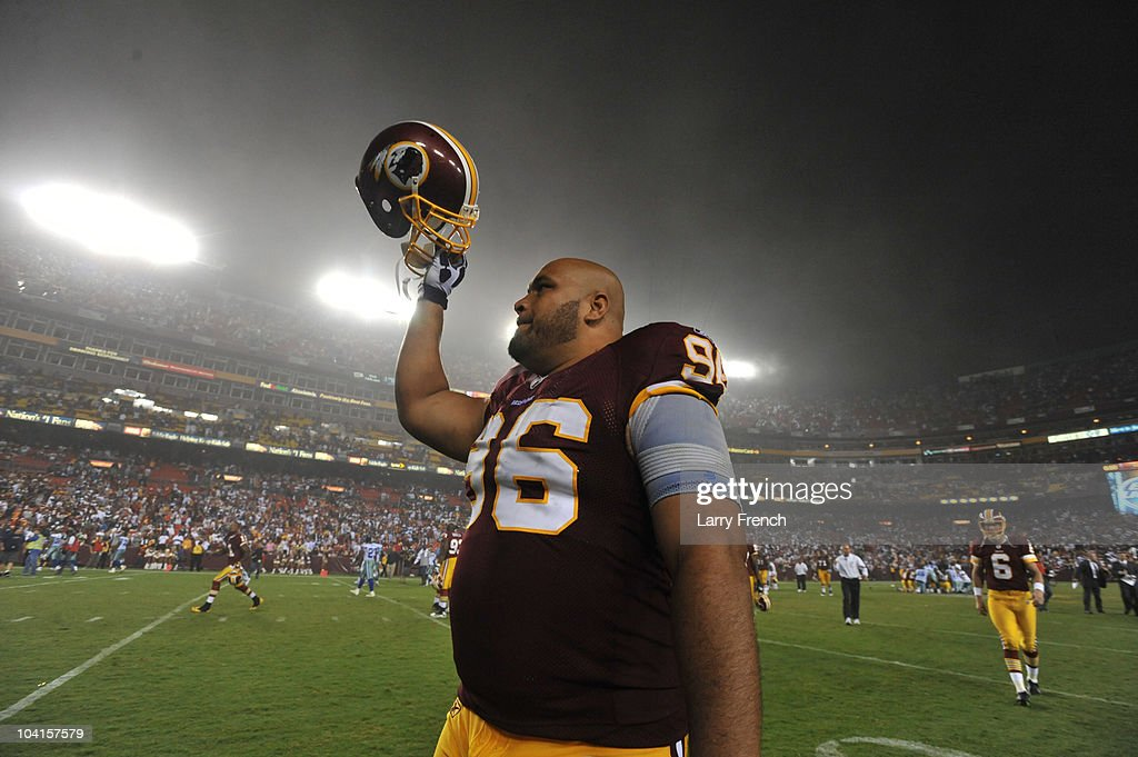 Maake Kemoeatu of the Washington Redskins celebrates the victory after the NFL season opener against the Dallas Cowboys at FedExField on September 12...