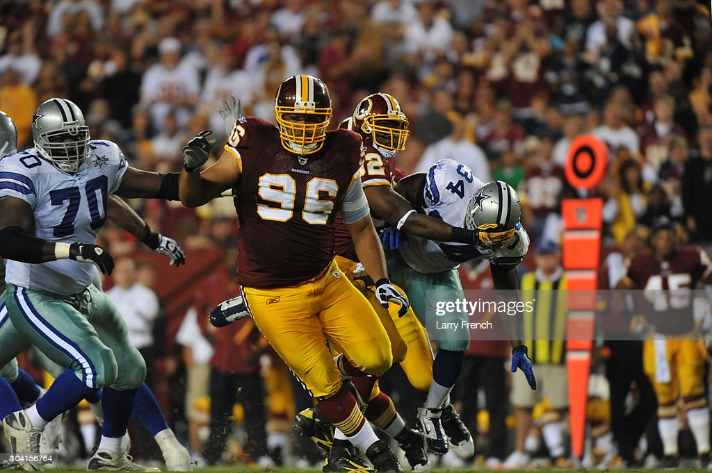 Maake Kemoeatu of the Washington Redskins defends during the NFL season opener against the Dallas Cowboys at FedExField on September 12 2010 in...