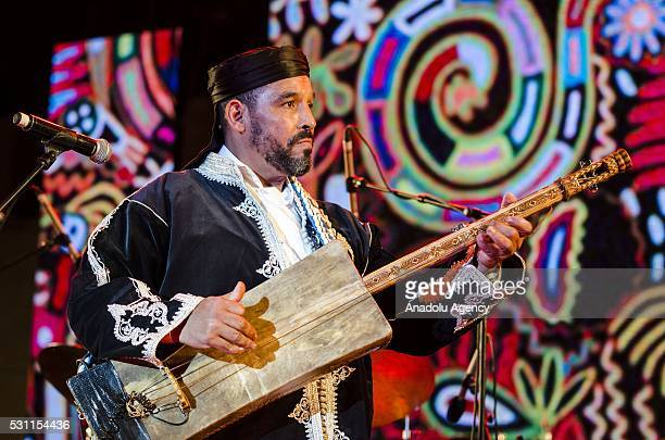 Maalem Said Koyo performs on the stage during 19th Annual Gnaoua Music Festival in Essaouira Morocco on May 13 2016