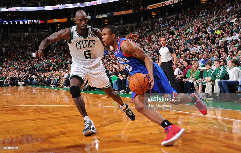 Maalik Wayns #18 of the Philadelphia 76ers drives to the basket against Kevin Garnett #5 of the Boston Celtics on December 8, 2012 at the TD Garden in Boston, Massachusetts.