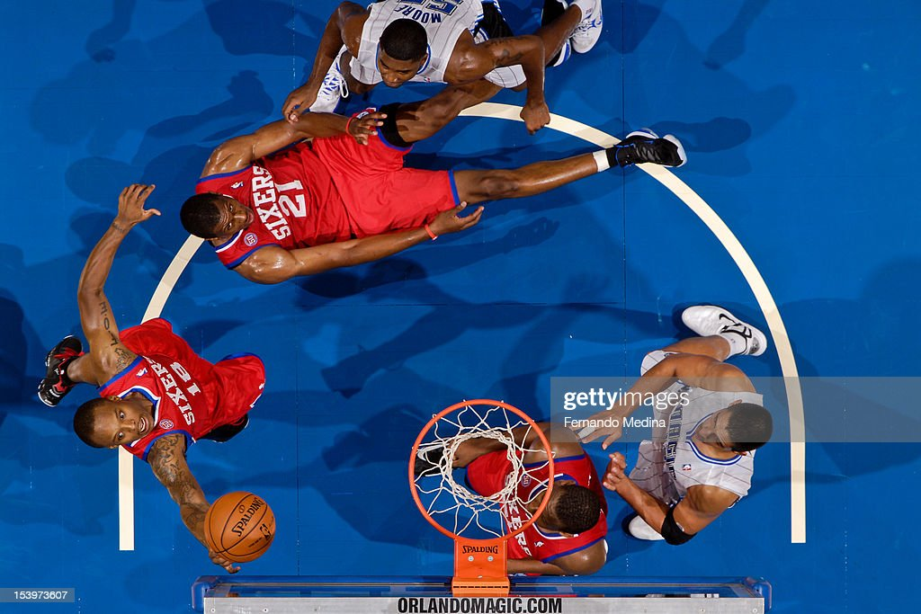 Maalik Wayns #18 of the Philadelphia 76ers goes for a rebound against the Orlando Magic during a pre-season game on October 11, 2012 at Amway Center in Orlando, Florida.