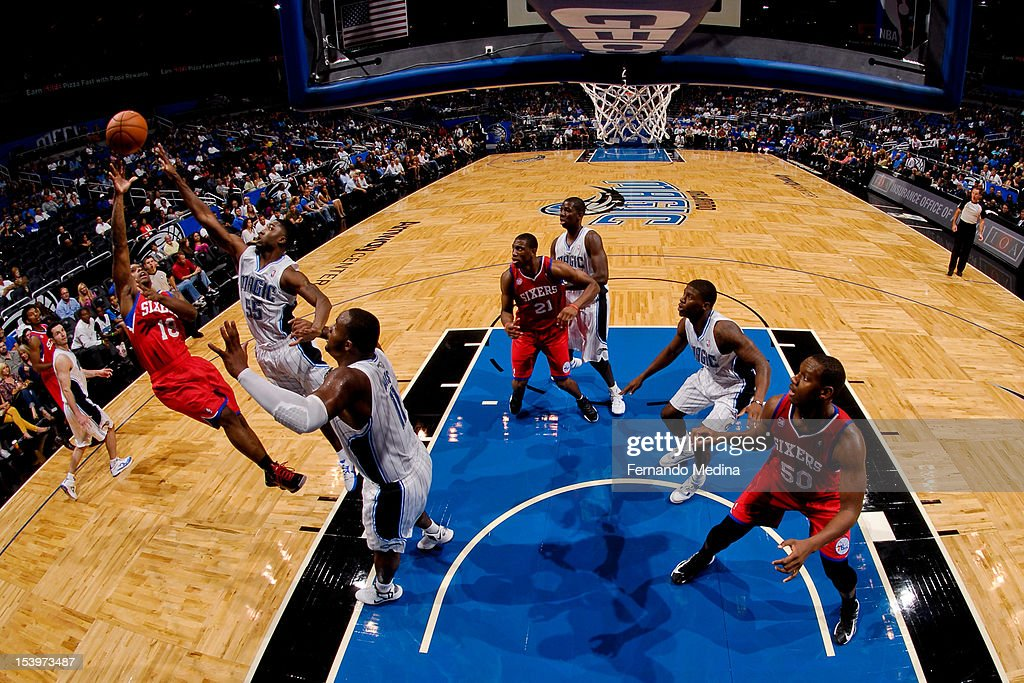 Maalik Wayns #18 of the Philadelphia 76ers shoots against <a gi-track='captionPersonalityLinkClicked' href=/galleries/search?phrase=E%27Twaun+Moore&family=editorial&specificpeople=4877476 ng-click='$event.stopPropagation()'>E'Twaun Moore</a> #55 of the Orlando Magic during a pre-season game on October 11, 2012 at Amway Center in Orlando, Florida.