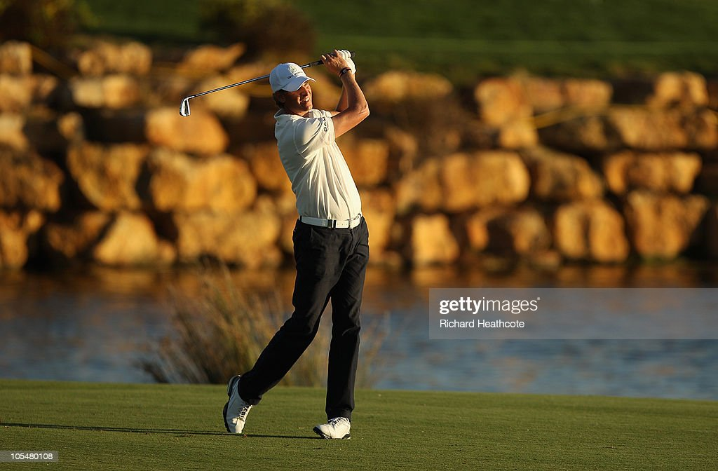 Maarten Lafeber of The Netherlands plays into the 18th green during the second round of the Portugal Masters at the Oceanico Victoria Golf Course on...