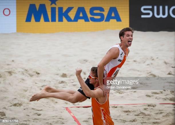 Maarten Van Garderen and Christiaan Varenhorst of Netherlands celebrate after the Men's Quarterfinal match between Netherlands and Spain on August 05...