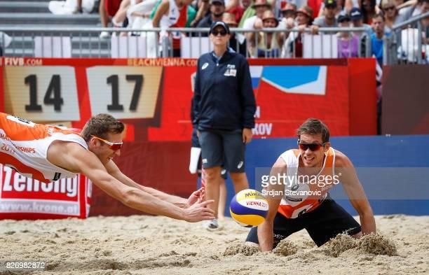 Maarten Van Garderen and Christiaan Varenhorst try to save the ball during the Men's Bronze medal match between Russia and Netherlands on August 06...