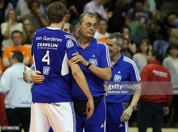 Maarten van Garderen of Friedrichshafen and head coach Stelian Moculescu look on after winning the Volleyball Bundesliga Playoffs final game 4...
