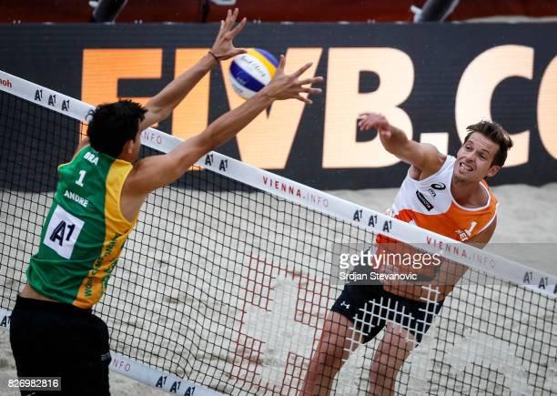 Maarten Van Garderen of Netherlands spikes the ball against Andre Loyola of Netherlands during the Men's SemiFinal match between Brazil and...
