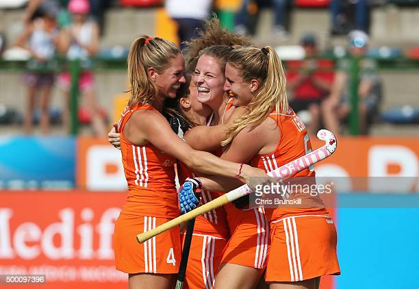 Maartje Krekelaar of the Netherlands celebrates scoring the opening goal with team mates during the Hockey World League Final Pool A match between...