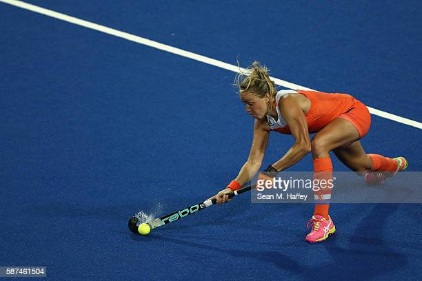Maartje Paumen of Netherlands passes the ball against Korea during a Women's Pool A match on Day 3 of the Rio 2016 Olympic Games at the Olympic...