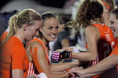 Maartje Paumen of the Netherlands celebrates with teammates after defeating Argentina in the shootout during their Women's Hockey World League...