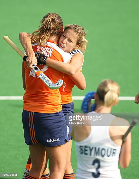 Maartje Paumen of the Netherlands celebrates with Wieke Dijkstra of the Netherlands after scoring a goal in the final play of the game making the...