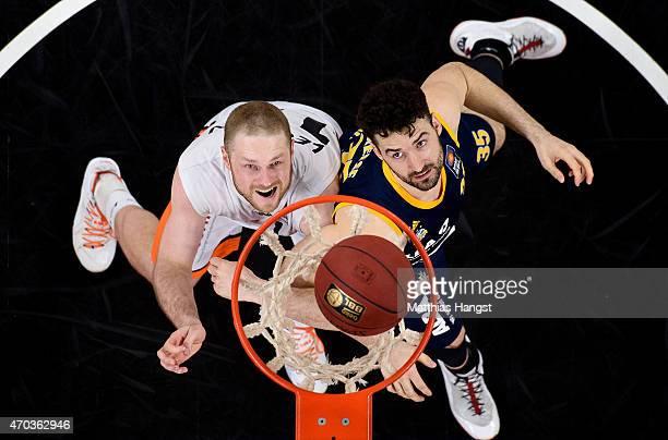 Maarty Leunen of Ulm and Jannik Freese of Berlin look fot the ball during the Beko Basketball Bundesliga match between Ratiopharm Ulm and Alba Berlin...