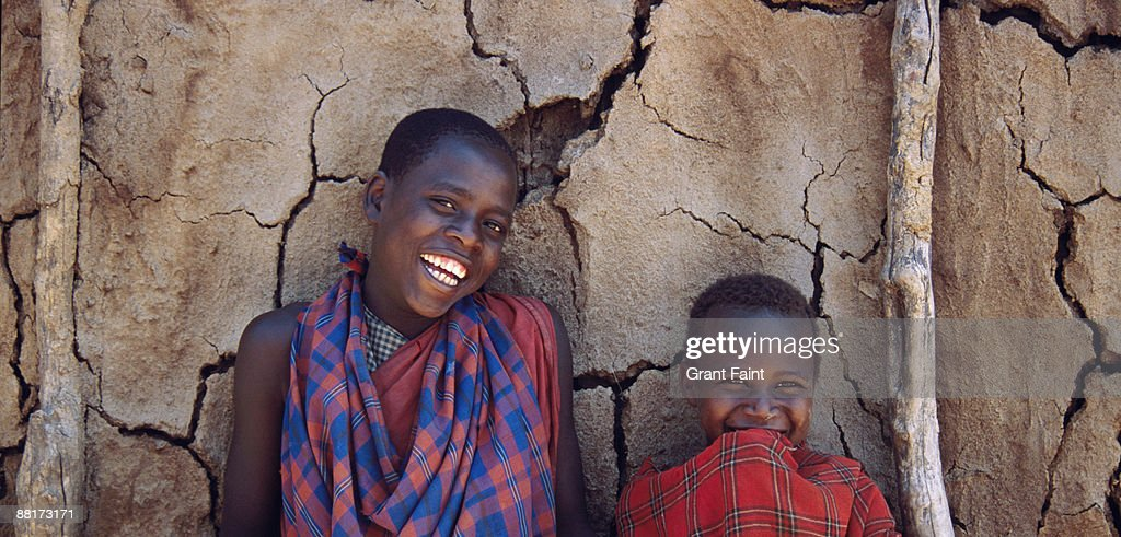 Maasai boys in front of mud hut, Kenya, Africa. : Stock Photo