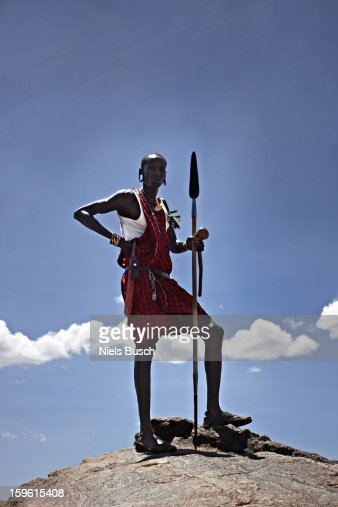 Maasai man standing on top of rock : Stock Photo