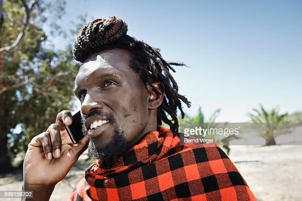 Maasai Man Using a Cell Phone