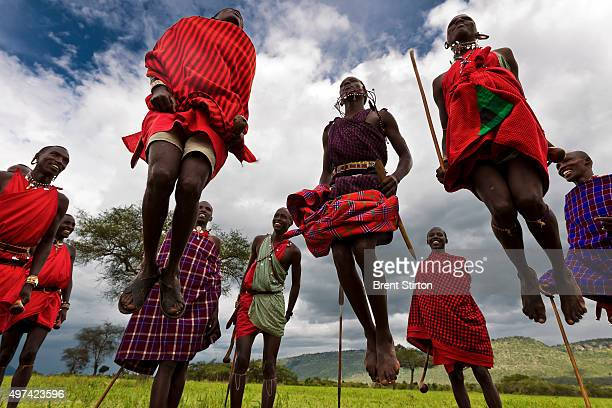 Maasai men practise a tradtional dance they will perfom for tourists as part of a new income plan for members of this community who have chosen...