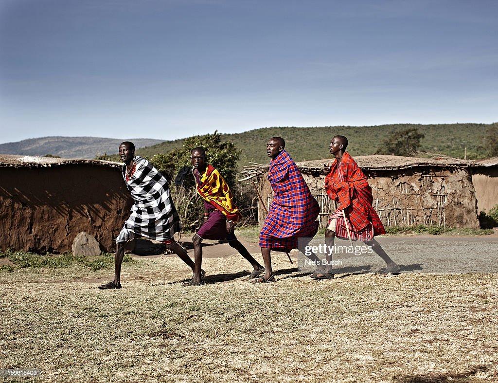 Maasai men walking together