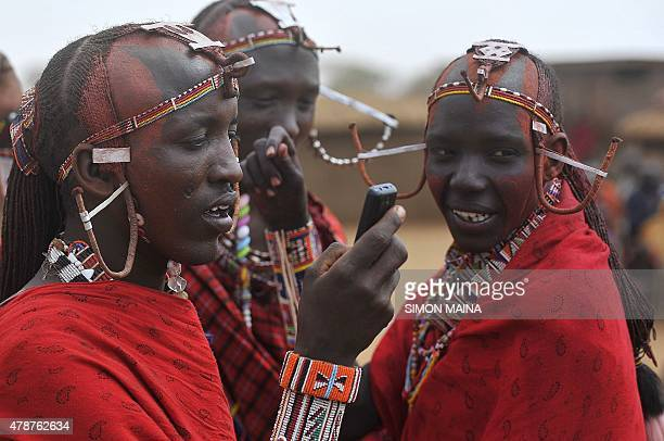 Maasai morans wait for the start of the ordination of the Maasai agegroup leader of the Iltuati morans in the village of Mbirukani in Kajiado on June...