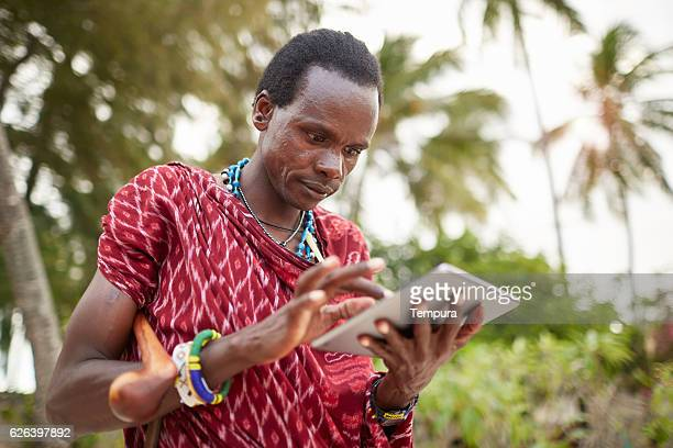 Maasai nomadic man using technology