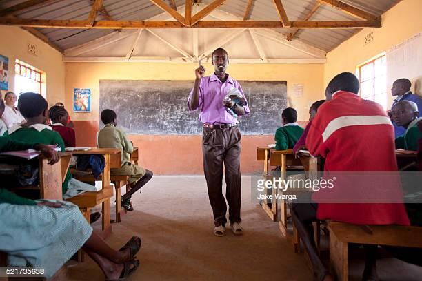 Maasai teacher instructing students in classroom
