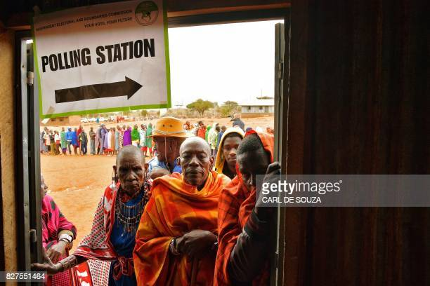 Maasai voters queue at a polling station in Saikeri Kajiado West County on August 8 2017 Kenyans began voting in general elections headlined by a...