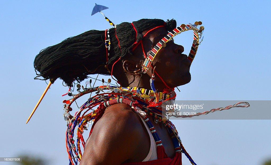 A Maasai warrior dances in Kiserian, outside Nairobi, on February 28, 2013. Kenya is preparing for national elections on March 4, 2013. AFP PHOTO/Carl de Souza