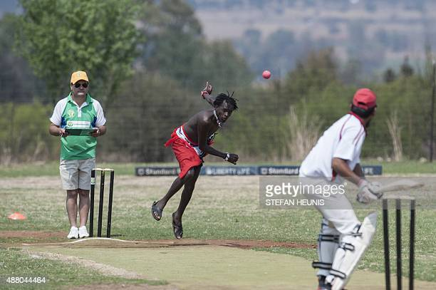 A Maasai Warriors cricket player bowls during a cricket match between Maasai Warriors and Glenvista Cricket Club invitational side at the...