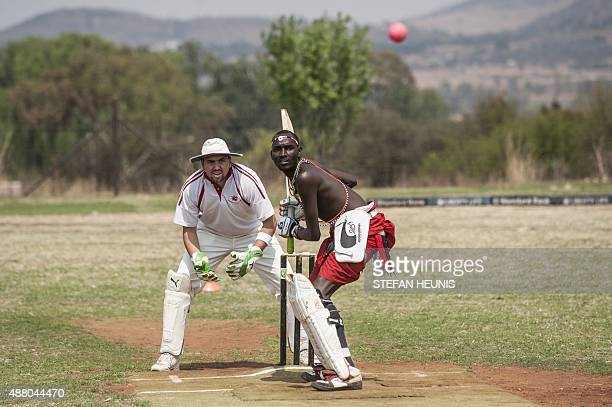 A Maasai Warriors cricket player gets ready to play a shot during a cricket match between Maasai Warriors and Glenvista Cricket Club invitational...