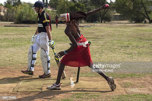 A Maasai Warriors cricket team player bowls during a game of cricket against Glenvista Cricket Club invitational side at the Klipriversberg...