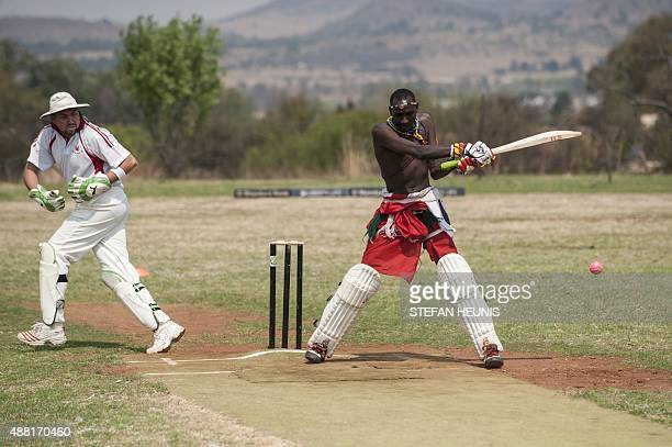 A Maasai Warriors cricket team player plays a shot during a game of cricket against Glenvista Cricket Club invitational side at the Klipriversberg...