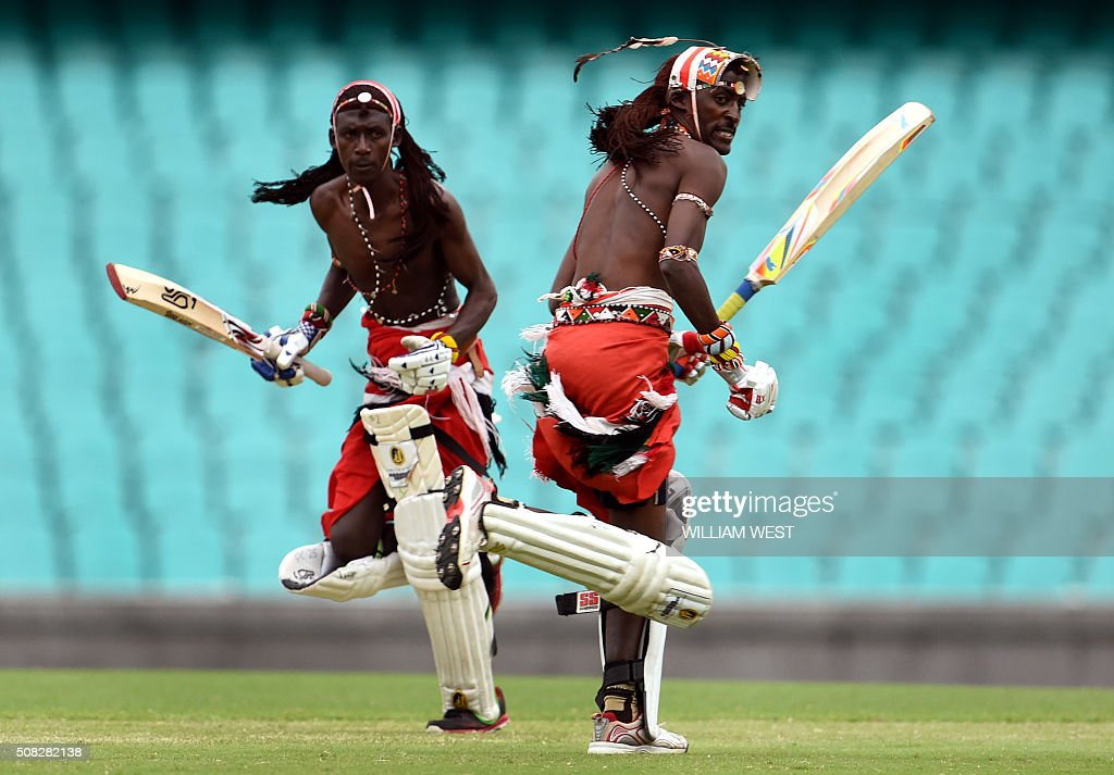 TOPSHOT - Maasai Warriors from Kenya take a run in their cricket match at the Sydney Cricket Ground (SCG) against a team comprising of Australian rugby union and rugby league players in Sydney on February 4, 2016. The bare-chested Maasai Warriors team dress in their traditional tribal attire as they tour the world playing cricket to raise awareness of social issues in their home country, campaigning against female genital mutilation and substance abuse, while promoting conservation.