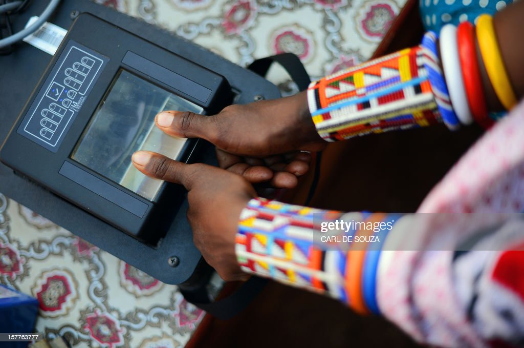 A Maasai woman has her fingerprints electronically recorded as she registers to vote in the village of Ewuaso Kedong in Kaijado County West on December 6, 2012. The Independent Electoral and Boundaries Commission (IEBC) has taken biometric computer equipment to populations in remote tribal areas in order to ensure that the chance of voting fraud is decreased for the country's forthcoming elections in March 2013. AFP PHOTO/Carl de Souza