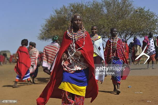 Maasai women gather during the ordination of the Maasai agegroup leader of the Iltuati morans in the village of Mbirukani in Kajiado on June 27 2015...