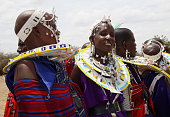 Maasai women prepare to greet Camilla Duchess of Cornwall and Prince Charles Prince of Walesas they visit Majengo Maasai Boma on November 9 2011 in...