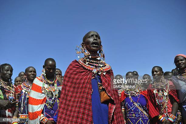 Maasai women sing during the ordination of the Maasai agegroup leader of the Iltuati morans in the village of Mbirukani in Kajiado on June 27 2015...