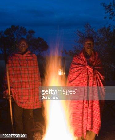 Maasaii men standing near campfire : Stock Photo