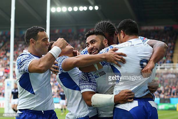 Ma'atulimanu Leiataua of Samoa celebrates with his team mates after scoring the 2nd try during the 2015 Rugby World Cup Pool B match between Samoa...