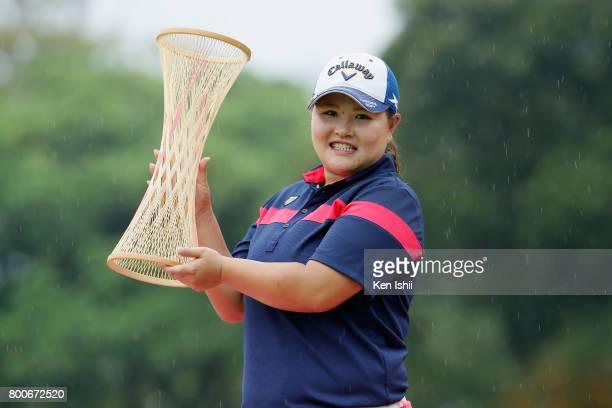 Maaya Suzuki of Japan celebrates with the trophy after winning the Yupiteru The Shizuoka Shimbun SBS Ladies at the Shizuoka Country Hamaoka Course on...