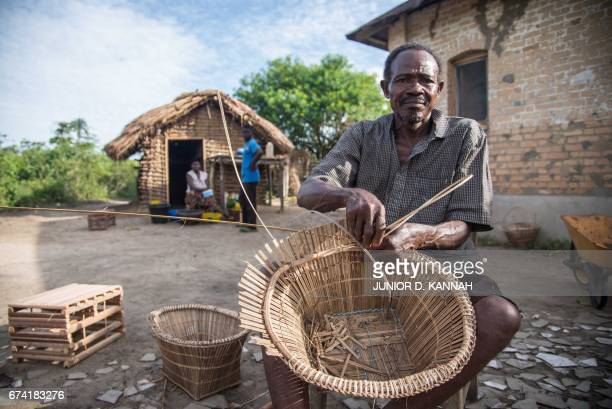 Mabanga Severin a palm nut cutter and a former worker of the PLZ factory and the PIH manufacturing industry works at the plantation camp of Kigangu...