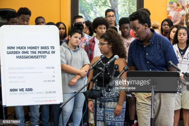 Mabel Gondres and Ayub Tahlil right from the Hyde Square Task Force Youth Development Center look at estimated fees that would be owed to the state...