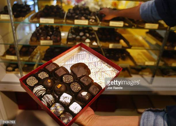 Mabel Herrera puts dark chocolate into a box August 27 2003 at Le Chocolatier in North Miami Beach Florida A recent study shows that eating dark...
