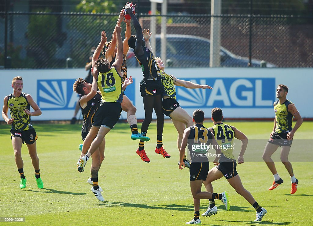 Mabior Chol of the Tigers takes a poweful contested mark in a large pack during the Richmond Tigers AFL intra-club match at Punt Road Oval on February 12, 2016 in Melbourne, Australia.