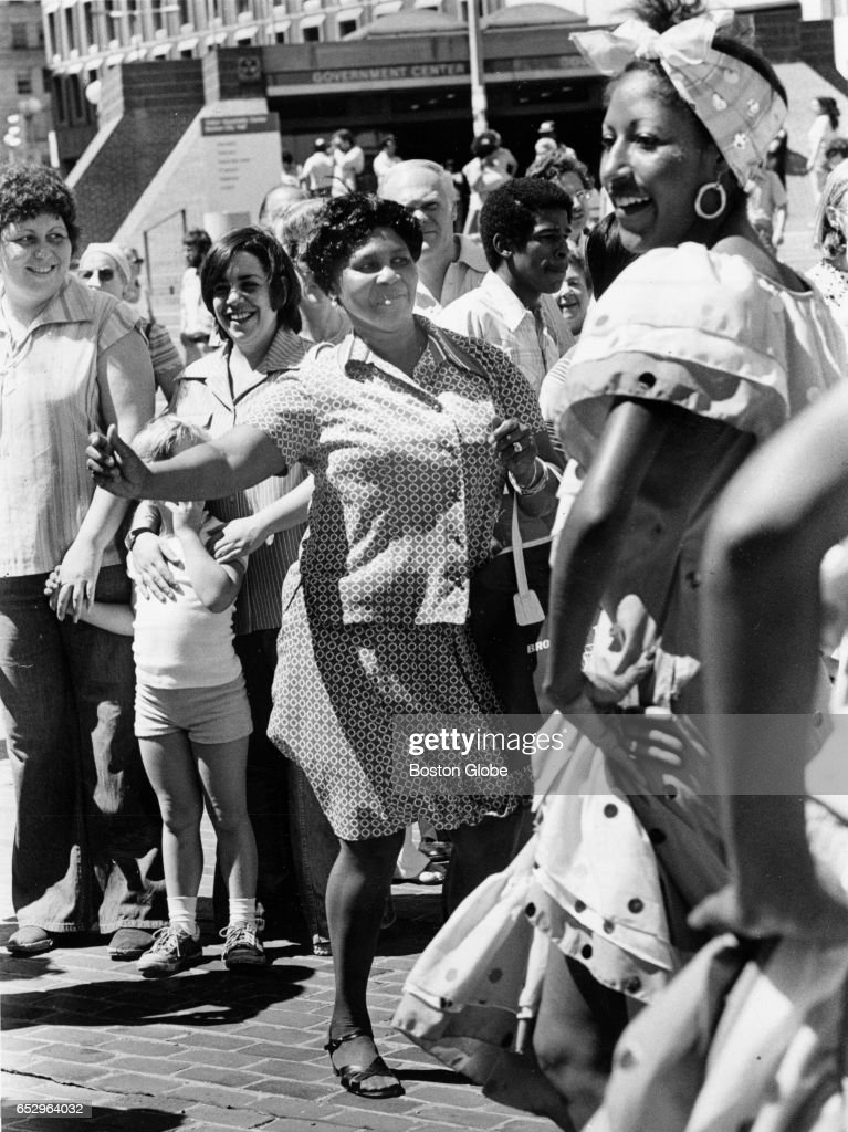 Mable Martin, a Boston resident originally from Angola, dances along with the calypso dancers on the Walk to the Sea celebrating the 10th anniversary of Summerthing in Boston on Jul. 2, 1977.