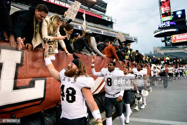 Mac Loudermilk of the UCF Knights highfives fans after the win at Lincoln Financial Field on November 18 2017 in Philadelphia Pennsylvania UCF...