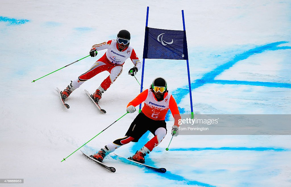 Mac Marcoux of Canada and guide Robin Femy compete in the Men's Giant Slalom Visually Impaired on day eight of the Sochi 2014 Paralympic Winter Games at Rosa Khutor Alpine Center on March 15, 2014 in Sochi, Russia.