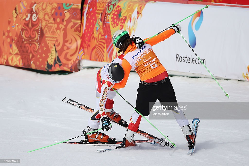 Mac Marcoux (L) of Canada is helped by guide Robin Femy in the Men's Giant Slalom Visually Impaired on day eight of the Sochi 2014 Paralympic Winter Games at Rosa Khutor Alpine Center on March 15, 2014 in Sochi, Russia.