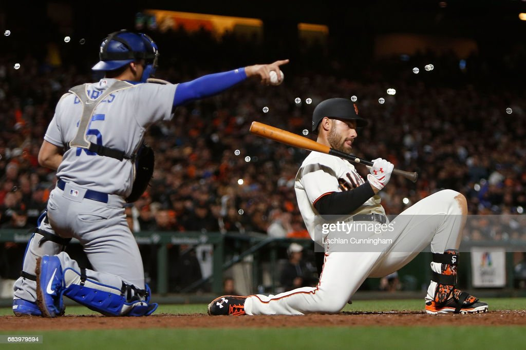 Mac Williamson #51 of the San Francisco Giants ducks under a pitch from Pedro Baez #52 of the Los Angeles Dodgers in the sixth inning at AT&T Park on May 16, 2017 in San Francisco, California.
